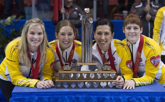Manitoba skip Jennifer Jones, left to right, third Kaitlyn Lawes, second Jill Officer and lead Dawn McEwen celebrate their win in the gold medal game against Alberta at the Scotties Tournament of Hear