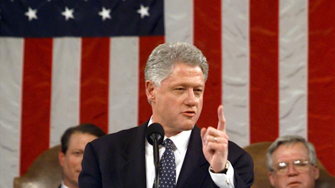 "FILE - In this Jan. 19, 1999 file-pool photo, President Bill Clinton gestures while giving his State of the Union address on Capitol Hill in Washington. Is ""strong"" losing its strength? Presidents of both parties have long felt compelled to sum up the state of the union with a descriptive word or two in their State of the Union addresses. Mostly the same word. For many years now, ""strong"" has been the go-to adjective. Vice President Gore, left, and House Speaker Dennis Hastert of Ill. listen. (AP Photo/Win McNamee, File-Pool)"
