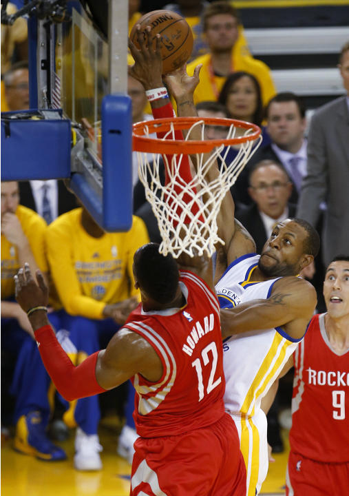 Houston Rockets center Dwight Howard (12) blocks a shot by Golden State Warriors forward Andre Iguodala during the first half of Game 5 of the NBA basketball Western Conference finals in Oakland, Cali