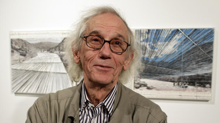 "FILE - This Jan. 23, 2013 file photo shows artist Christo posing in front of his proposed ""Over the River"" project at the Metropolitan State University Center for Visual Art in Denver. Christo says opposition to his planned ""Over the River"" project on the Arkansas River is part of the art. (AP Photo/Brennan Linsley, file)"