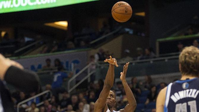 Orlando Magic's Maurice Harkless shoots a jumper against the Dallas Mavericks during the first half of an NBA basketball game in Orlando, Fla., Saturday, Nov. 16, 2013