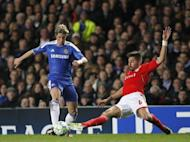 Chelsea's Ferando Torres (L) vies with Benfica's Javi Garcia during their UEFA Champions League quarter finals football match at Stamford Bridge, West London. Chelsea survived a nervous finale against 10-man Benfica to earn a 2-1 win in the Champions League quarter-final second leg and set up a last-four showdown with holders Barcelona