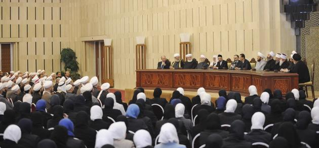 Syria's President Bashar al-Assad attends a meeting with clergymen and preachers in Damascus, in this handout photograph released by Syria's national news agency SANA
