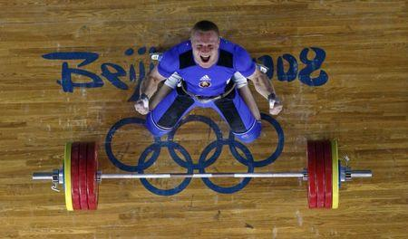 Andrei Rybakou of Belarus reacts after lifting 209kg in the men's 85kg Group A clean and jerk weightlifting competition at the Beijing 2008 Olympic Games