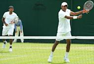 """India's Mahesh Bhupathi plays a shot at the net during his first round men's doubles match with India's Rohan Bopanna (L) at Wimbledon. Bhupathi on Wednesday slammed India's tennis chiefs for putting top female player Sania Mirza in an """"unbelievable position"""" in the country's bitter Olympic selection row"""