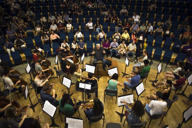 Israeli-born violinist Perlman leads students rehearsing during a media event at Israel Conservatory of Music in Tel Aviv