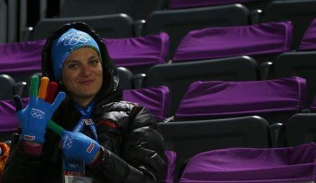 Isinbayeva sits in the tribune during second jump of the men's ski jumping large hill individual qualification round at the Sochi 2014 Winter Olympics