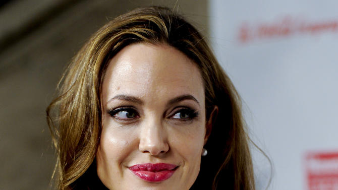 "FILE - This March 8, 2012 file photo shows actress Angelina Jolie at the Women in the World Summit in New York. Jolie says that she has had a preventive double mastectomy after learning she carried a gene that made it extremely likely she would get breast cancer. The Oscar-winning actress and partner to Brad Pitt made the announcement in  an op-ed she authored for Tuesday's New York Times under the headline, ""My Medical Choice."" She writes that between early February and late April she completed three months of surgical procedures to remove both breasts.  (AP Photo/Evan Agostini, file)"