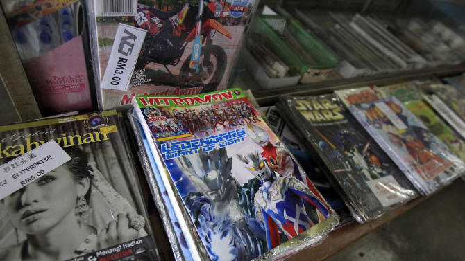 "An Ultraman comic book is on display for sale at a book store in Port Klang, outside Kuala Lumpur, Malaysia, Friday, March 7, 2014. Malaysia has banned an Ultraman comic book because it uses the word ""Allah"" to describe the Japanese action hero. The Home Ministry said in a statement Friday that the Malay-edition of ""Ultraman, The Ultra Power"" contained elements that can undermine public security and societal morals. (AP Photo/Lai Seng Sin)"