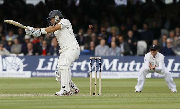 New Zealand's Ross Taylor plays a shot off the bowling of England's James Anderson during the second day of the first Test match between England and New Zealand at Lord's cricket ground in