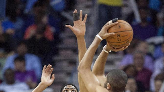 Portland Trail Blazers forward Nicolas Batum (88) shoots over New Orleans Pelicans forward Anthony Davis (23) in the second half of an NBA basketball game in New Orleans, Friday, March 14, 2014. The Trail Blazers won 111-103