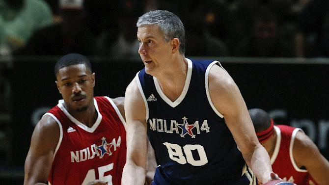 Education Secretary Arne Duncan (80), of the East team, brings the ball up as West's Michael B. Jordan (45) trails the play in the first half of the NBA All-Star celebrity basketball game in New Orleans, Friday, Feb. 14, 2014