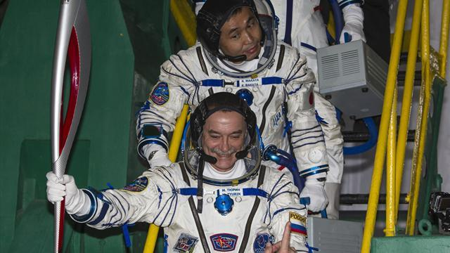 Olympic Games - Russian Soyuz rocket flies Olympic torch to space station