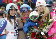 Sarah Schleper, second from left, holds her son Lasse as she poses with her teammates Julia Mancuso, left, and Lindsey Vonn, in the finish area of an alpine ski, women's World Cup slalom, in Lienz, Austria, Thursday, Dec. 29, 2011. American skier Sarah Schleper, who competed in four Winter Olympics, says Thursday's slalom will be the last World Cup race of her career. The 32-year-old Schleper will retire after 15 years and 186 races since making her World Cup debut in her native Vail, Colorado, in 1995. (AP Photo/Giovanni Auletta)