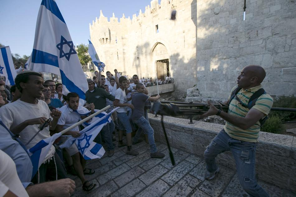 Israelis taking part in a march marking Jerusalem Day scuffle with a Palestinian cameraman outside Jerusalem's Old City