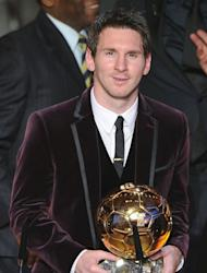 "Lionel Messi poses after receiving, for the third time, the FIFA Ballon d'Or award in January. ""My objective at the start of the season was to win another La Liga title,"" said Messi, who is in line to win a record fourth successive Ballon d'Or"