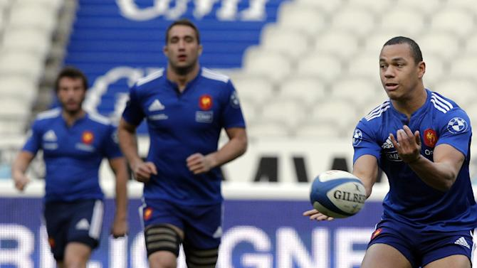 France's Gael Fickou passes the ball during a training session at the stade de France stadium, in Saint Denis, outside Paris, Friday, March 14, 2014. France will play Ireland during a Six Nations Rugby Union match on March 15