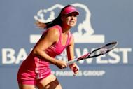 Sorana Cirstea of Romania prepares to return a shot against Dominika Cibulkova of Slovakia during the Bank of the West Classic at Stanford University Taube Family Tennis Stadium on July 13 in Stanford, California. Cirstea roared back to upset Cibulkova 6-7 (5/7), 6-2, 6-0