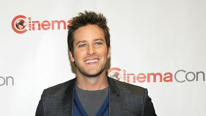 "Armie Hammer, who stars in the title role in the upcoming film ""The Lone Ranger,"" poses backstage during the Walt Disney Studios presentation at CinemaCon 2013 at Caesars Palace on Wednesday, April 17, 2013 in Las Vegas. (Photo by Chris Pizzello/Invision/AP)"