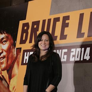 """HOLD FOR STORY - FILE - In this Nov. 24, 2014 file photo, Shannon Lee, daughter of Bruce Lee and president of the """"Bruce Lee Foundation,"""" poses for photographers during a press conference launching instant drinks in her father's name in Hong Kong. The legendary martial arts star Bruce Lee is getting the official biopic treatment, daughter Shannon Lee, announced Friday, Feb. 27, 2015. Bruce Lee Entertainment will produce the project in collaboration with Lawrence Grey (""""Hope Springs"""") and Janet Yang (""""The Joy Luck Club""""). (AP Photo/Vincent Yu, File)"""