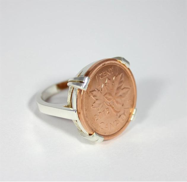 One of the rings displayed on Coin Coin designs & co.'s Facebook page. Renee Gruszecki designs jewelry from coins.