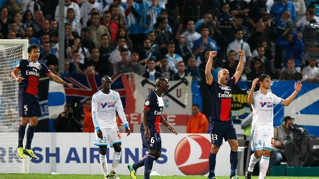 Paris Saint Germain's Brazilian defender Marquinhos, left, Paris Saint Germain's French defender Zoumana Camara, center, Paris Saint Germain's Brazilian defender Alex, react after defeating Marseille, during their League One soccer match, at the Velodrome Stadium, in Marseille, southern France, Sunday, Oct. 6, 2013