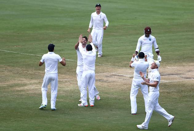 Cricket: England's James Anderson celebrates the wicket of Marlon Samuels