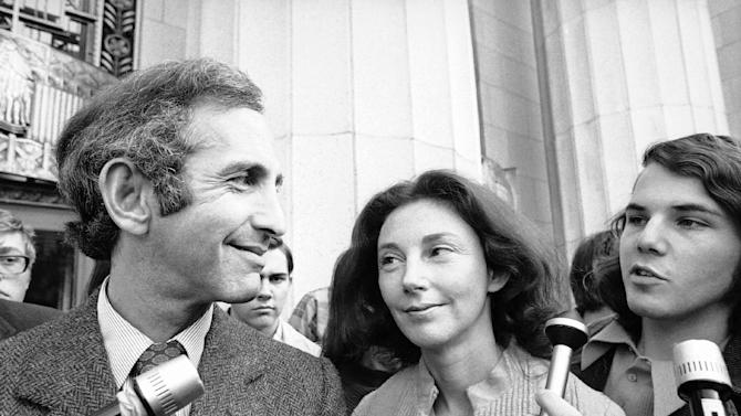 In this Wednesday, April 12, 1973 photo, Daniel Ellsberg, co-defendant in the Pentagon Papers trial, talks with newsmen after he testified in Los Angeles. Next to him is his wife, Patricia. Ellsberg, who vividly described his journey to disillusionment in Vietnam on Wednesday, will climax that story on Thursday, telling jurors how he risked his government career to copy the Pentagon Papers, hoping to end the war. As the last U.S. combat troops left Vietnam 40 years ago, angry protesters still awaited them at home. North Vietnamese soldiers took heart from their foes' departure, and South Vietnamese who had helped the Americans feared for the future. While the fall of Saigon two years later — with its indelible images of frantic helicopter evacuations — is remembered as the final day of the Vietnam War, Friday marks an anniversary that holds greater meaning for many who fought, protested or otherwise lived it.  (AP Photo)