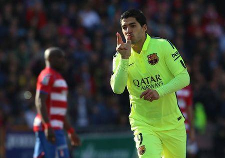 Barcelona's Suarez celebrates after scoring a goal against Granada during their Spanish first division soccer match in Granada
