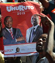 A poster of Uhuru Kenyatta (left) and William Ruto at a rally in Nairobi on Wednesday. With little time left before the March 4 election, the High Court ruling effectively clears the way for Kenyatta to contest the polls, in which he is seen as one of the leading candidates for the country's top job