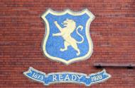 The emblem of Glasgow Rangers football club is pictured at the club in Glasgow. Fallen giants Rangers have accepted a one-year transfer ban, beginning on September 1, to ensure their membership of the Scottish Football Association (SFA)
