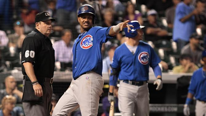 Baez homers in debut as Cubs top Rockies, 6-5