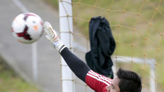 Mexico's goalkeeper Moises Munoz dives for a ball at a training session for their 2014 World Cup qualifying playoff second leg soccer match against New Zealand in Wellington