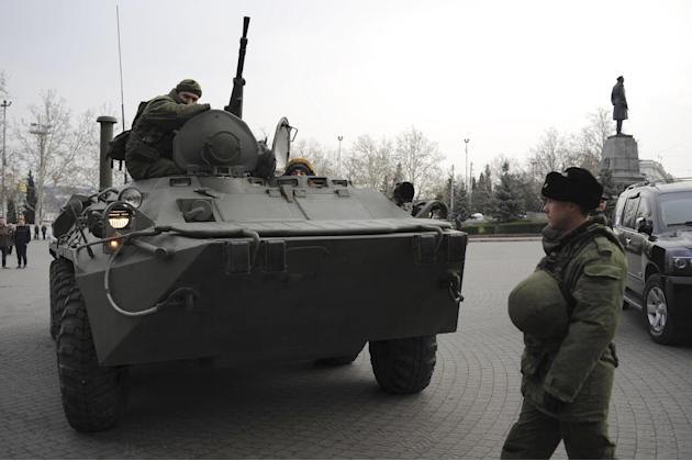 A Russian armored personnel carrier is driven on a street in Sevastopol, Ukraine's Black Sea Port that hosts a major Russian navy base Tuesday, Feb. 25, 2014. Tensions were building up in the Crimea,