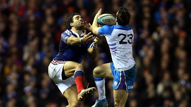 France's Yohan Huget, left, is tackled by Scotland's Max Evans, right, during their Six Nations rugby union international match at Murrayfield in Edinburgh, Scotland, Saturday March 8, 2014. (AP Photo/Scott Heppell)