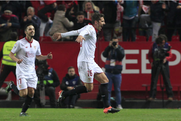 Sevilla's Stevan Jovetic, right, celebrates celebrates after scoring during La Liga soccer match between Real Madrid and Sevilla at the Ramon Sanchez Pizjuan stadium, in Seville, Spain on Sunday,