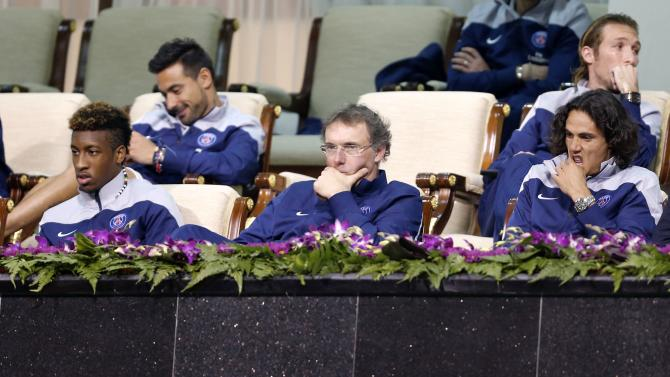 Paris Saint Germain manager Laurent Blanc watches the tennis match between Rafael Nadal and Tobias Kamke during their Qatar Open tennis match in Doha
