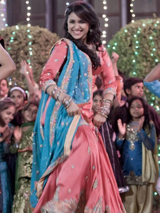 Images via : iDiva.comParineeti Chopra is wearing a typical north Indian garara in pink and blue in the film Ishaqzaade. The dress may be a little simple for bridal wear but you can wear something sim