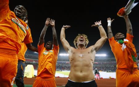 Ivory Coast's head coach Renard celebrates with his players after winning the African Nations Cup final soccer match against Ghana in Bata