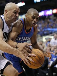 Dallas Mavericks' Jason Kidd, and Oklahoma City Thunder's Russell Westbrook, right, fight for the loose ball going out of bounds in the first half of Game 3 in the first round of the NBA basketball playoffs series, Thursday, May 3, 2012, in Dallas. (AP Photo/Tony Gutierrez)