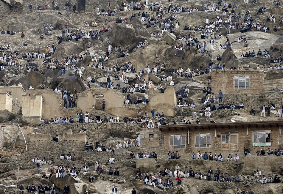 People gather near a shrine to celebrate Newroz in Kabul