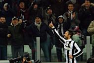 "Juventus' Montenegro forward Mirko Vucinic celebrates after scoring during the Italian Cup football match between Juventus and AC Milan at the ""Juventus Stadium"" in Turin on January 9, 2013. Vucinic gave Juventus a 2-1 victory over AC Milan on Wednesday and a place in the Italian Cup semi-finals"