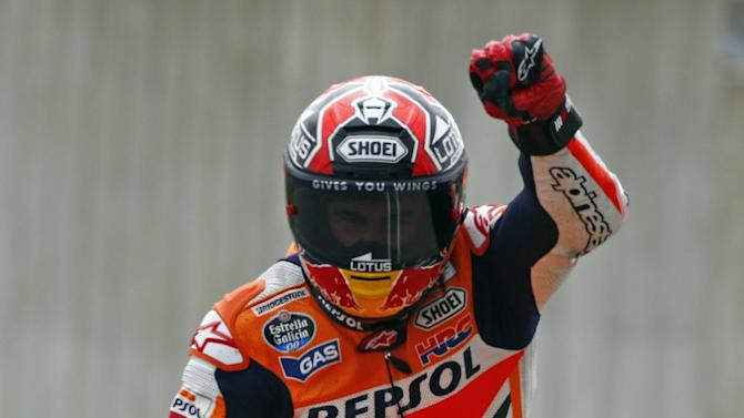 Motorcycling - Marquez still on top in Valencia despite crash