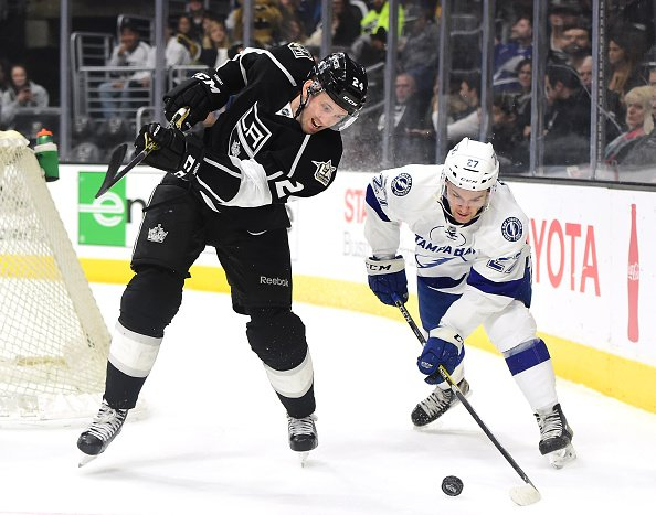 Derek Forbort #24 of the Los Angeles Kings fails to clear the puck as he is checked by Jonathan Drouin #23 of the Tampa Bay Lightning during the first period at Staples Center on January 16, 2017 in Los Angeles, California. (Photo by Harry How/Getty Images)