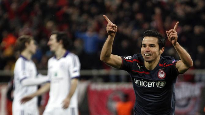 Olympiakos' Saviola celebrates a goal against Anderlecht during their Champions League soccer match in Athens