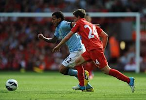 Carlos Tevez, left, scored City's second equaliser of the day to ensure his side remain unbeaten