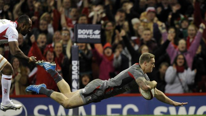 Wales' Owen Williams scores a try against Tonga during their international rugby union match at the Millennium Stadium in Cardiff,