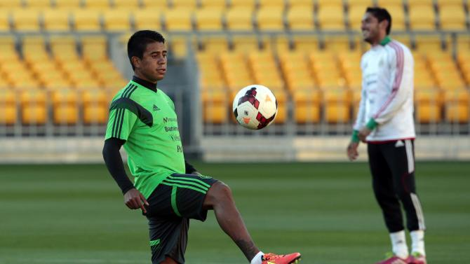 Mexico's Medina kicks a ball during a training session for their 2014 World Cup qualifying playoff second leg soccer match against New Zealand in Wellington