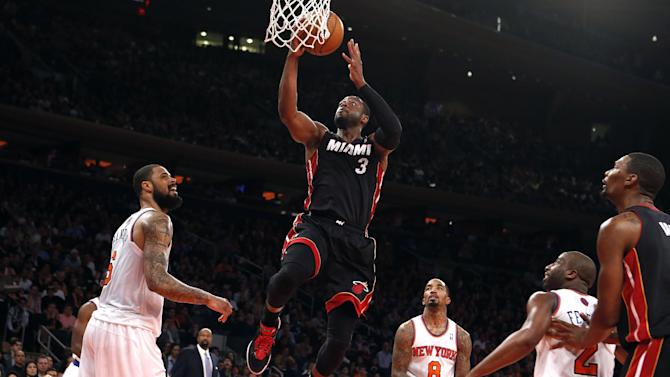 Miami Heat's Dwyane Wade (3) goes to the basket against the New York Knicks during the second half of an NBA basketball game Saturday, Feb. 1, 2014, in New York.  Miami won 106-91