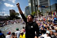 A demonstrator shouts slogans against Venezuela's President Nicolas Maduro during a protest asking for the disarmament of armed groups in Caracas, Venezuela, Sunday, Feb. 16, 2014. For the past several days, protests have rocked Caracas yielding several dead and scores of wounded in clashes between opposition protesters with security forces and pro-government supporters. (AP Photo/Alejandro Cegarra)